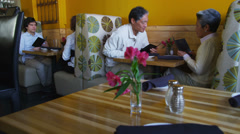 Senior couple eating at restaurant Stock Footage