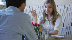 Young couple talking and having lunch together Stock Footage