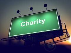 Charity - Billboard Sunrise taustalla. Piirros