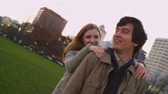 Young couple playing at city park, slow motion - stock footage