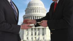 Politician giving bribe in front of US Capitol building - stock footage
