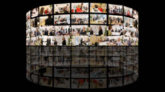 A giant bank of media screens showing hundreds of video and film clips. A news - stock footage