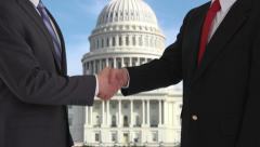 Politicians shaking hands in front of US Capitol Stock Footage