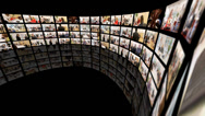 Stock Video Footage of Business media wall montage. A mass of HD screens form a wall, showing a variety