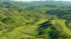 Aerial shot of rolling green hills - stock footage