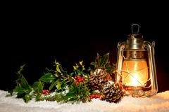 lantern with holly and ivy - stock photo