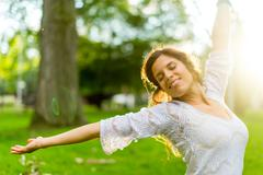 serene young woman expressing freedom in nature - stock photo