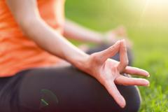 Stock Photo of closeup of a woman practicing yoga in nature