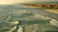 Stock Video Footage of Flying over coast and waves at sunset, aerial shot