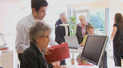Diverse business group hard at work in a busy office Stock Footage