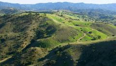 Time lapse aerial shot of rolling green hills Stock Footage