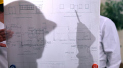 Architects or engineers in creative office looking at design plans. Stock Footage