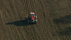 Agriculture, aerial shot of tractor plowing field Stock Footage