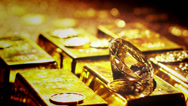 Stock Video Footage of Gold bars, coins and riches.  A scene of cluttered treasure and diamonds.