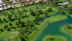 Aerial shot of a golf course, Palm Springs California - stock footage