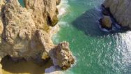 Stock Video Footage of Cabo aerial view straight down over the arch at lands end