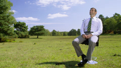 Businessman relaxing outside. Corporate responsibility concept. Stock Footage