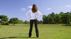 Businesswoman  surrounded by nature. Corporate responsibility concept. - stock footage