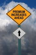 Premium increases ahead roadsign Stock Photos