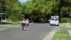 Three Pretty Uniformed Teen School Girls Crossing the Street Stock Footage
