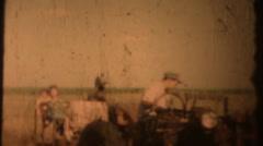 Vintage  movies, 1956 on farm tractor Stock Footage