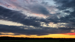 Cloud melts at sunset. Time Lapse. 4K - stock footage