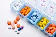 Stock Photo of schedule box containing capsules and capsules
