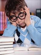 bored kid studying - stock photo