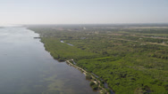 Stock Video Footage of Wide aerial shot half orbit of the bank of the Indian River along Fort Pierce