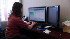 Jib shot of female geologist in office Stock Footage