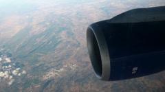 Aeroplane window seat view with turbine in flight Stock Footage