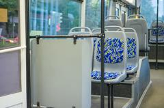 blue seat places in modern city trolley bus on back side - stock photo