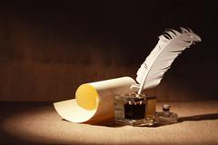 quill and scroll - stock photo