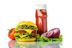 Hamburger, vegetables and ketchup Stock Photos
