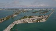 Stock Video Footage of Wide aerial shot of islands north of the MacArthur Causeway with medium traffic