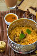 chicken biryani in small wok - stock photo