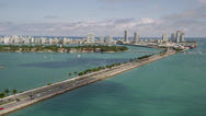 Stock Video Footage of Wide aerial shot following the MacArthur Causeway with medium traffic while