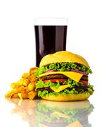 Hamburger, french fries and drink Stock Photos