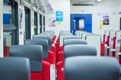 Rows of seats with headrests in modern suburb commuter train Stock Photos