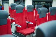 Stock Photo of rows of seats with headrests and armrestes in modern suburb commuter train