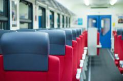 Stock Photo of corridor with rows of seats with headrests in modern suburb commuter train