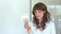 Young women showing five euro bill Stock Footage