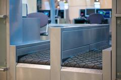 Stock Photo of luggage accept terminal with baggage handling belt conveyor syst