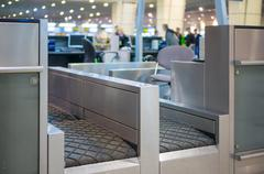 luggage accept terminal with baggage handling belt conveyor system at check i - stock photo