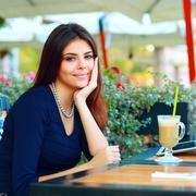 Elegant beautiful woman with tablet computer drinking coffee at cafe Stock Photos