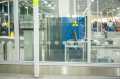 Security gates with metal detectors and x-ray scanners at entrance of airport Stock Photos