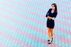 Full-length shot of a happy beautiful businesswoman in formal dress outdoors Stock Photos