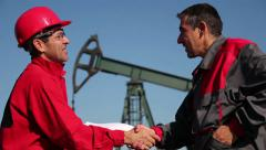 Two Oil and Gas Engineers Shaking Hands Stock Footage
