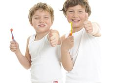 two little brother brushing teeth - stock photo