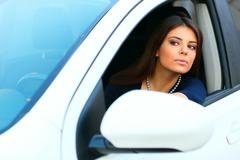 Young beautiful woman in a modern white car Stock Photos